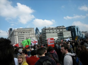"March Across London Bridge, with the ""Gherkin"" Building in the Background"